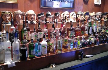 Mug collection behind the bar at Six Pence Restaurant and Pub in Blowing Rock, N.C. (Photo by Wil Elrick/permission required)