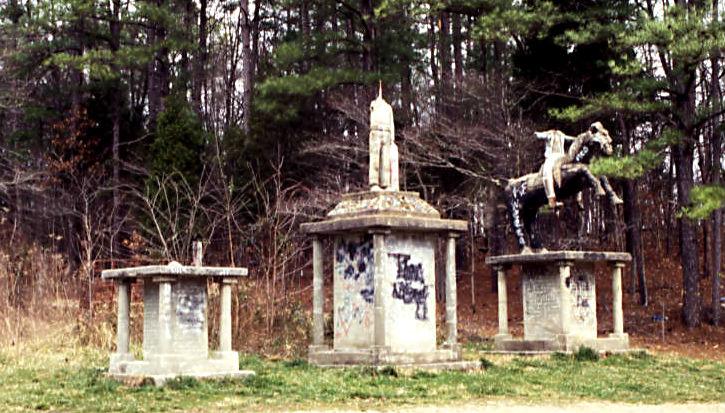 ET_Wickham_roadside_park_and_Wickham_Cemetery_three_broken_statues